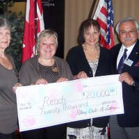 Ladner Rotary present cheque to REACH Society